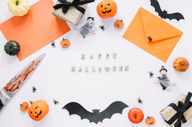Décorations avec inscription happy halloween au milieu Photo gratuit