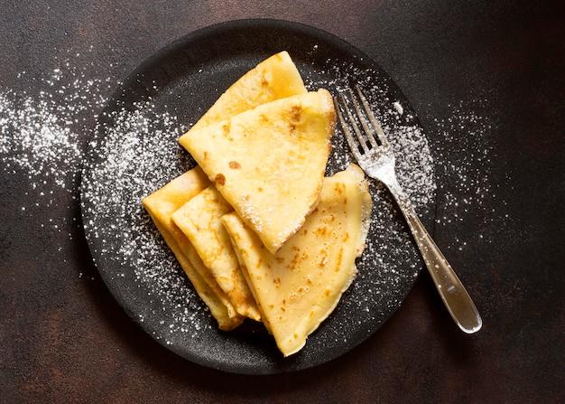 Délicieux Dessert Crêpe D'hiver Et Vue De Dessus De Sucre Photo gratuit