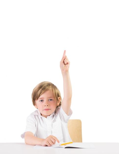 Désireux étudiant posant une question sur fond blanc Photo Premium