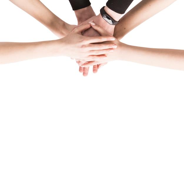 De dessus les mains pliées ensemble Photo gratuit