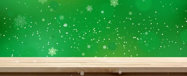 Dessus de table en bois sur fond de bokeh vert avec neige blanche, bannière panoramique Photo Premium