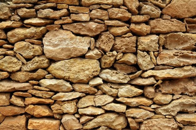 Détail de la maçonnerie de pierre sur les îles baléares Photo Premium