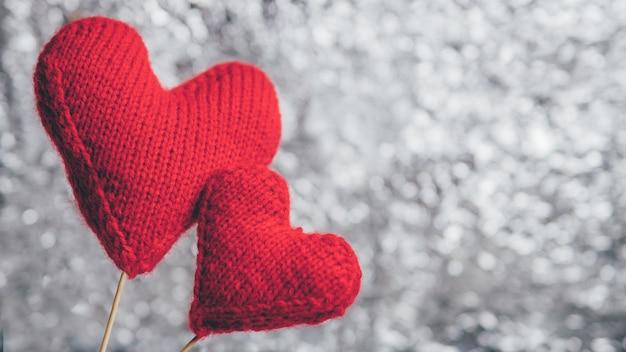 Deux coeurs rouges avec fond Photo Premium