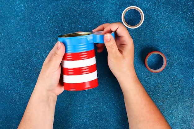 Diy vase 4 juillet de boîte de conserve Photo Premium
