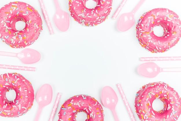 Donuts Et Cuillères Photo gratuit