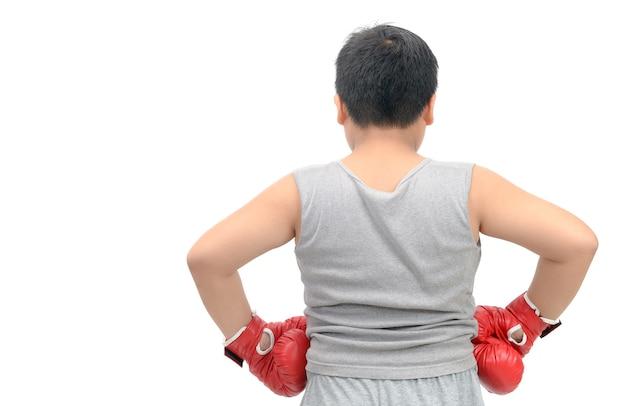 Dos d'un gros garçon avec des gants de boxe rouges i Photo Premium