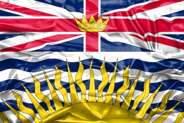 Drapeau de la colombie-britannique sur la texture de la soie douce et lisse Photo Premium