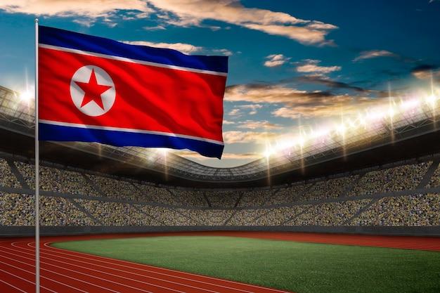 Drapeau De La Corée Du Nord Devant Un Stade D'athlétisme Avec Des Fans. Photo gratuit