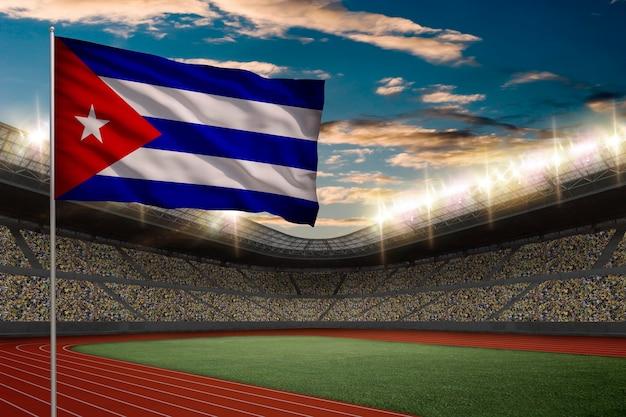 Drapeau Cubain Devant Un Stade D'athlétisme Avec Des Fans. Photo gratuit