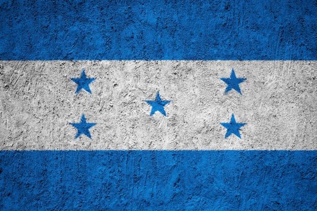 Drapeau du honduras peint sur le mur de grunge Photo Premium