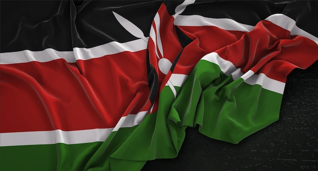 Drapeau du kenya enroulé sur un fond sombre 3d render Photo gratuit