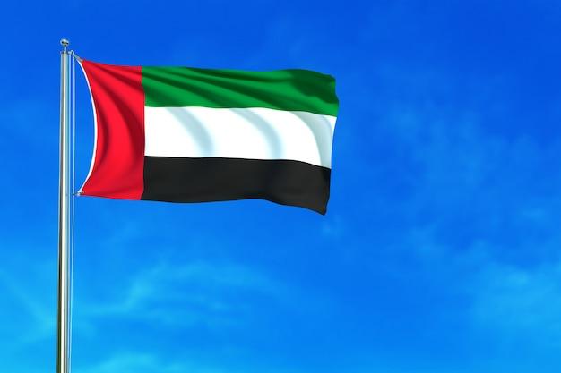 Drapeau des émirats arabes unis sur le rendu 3d de fond de ciel bleu Photo Premium