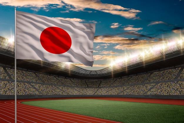 Drapeau Japonais En Face D'un Stade D'athlétisme Avec Des Fans. Photo gratuit