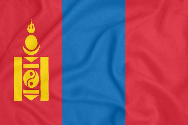 Drapeau de la mongolie sur tissu texturé. symbole patriotique Photo Premium