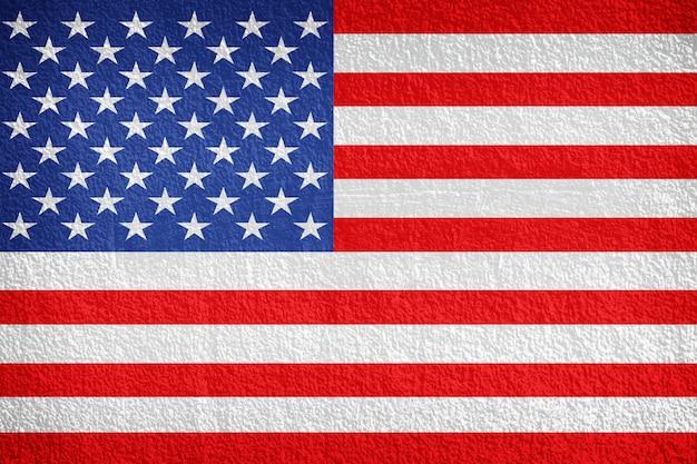 Drapeau national américain sur fond de mur en pierre Photo Premium