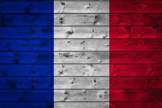 Le Drapeau National De La France Est Peint Sur Un Camp De Planches Même Clouées Avec Un Clou. Photo Premium