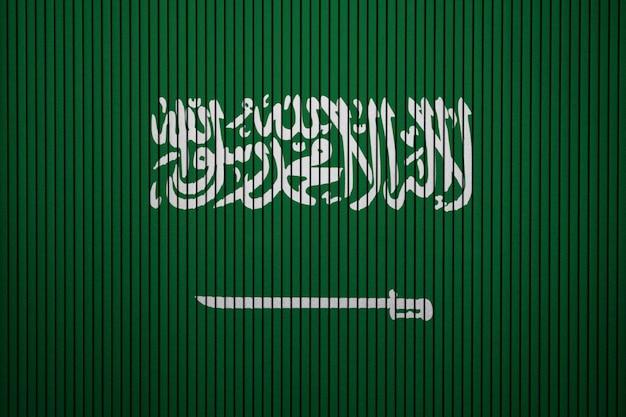 Drapeau national peint de l'arabie saoudite sur un mur de béton Photo Premium