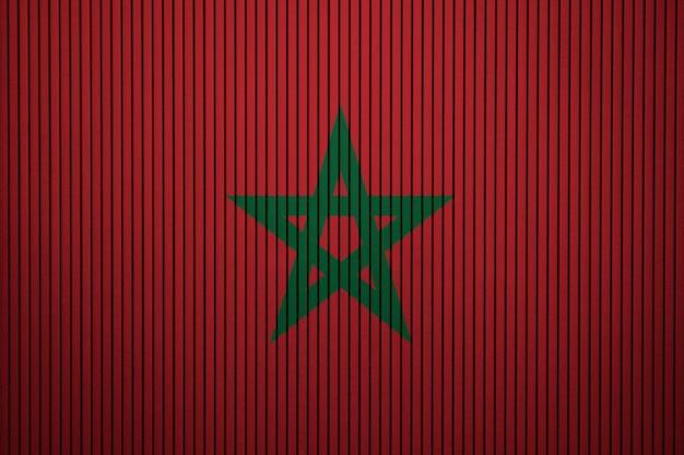 Drapeau national peint du maroc sur un mur de béton Photo Premium