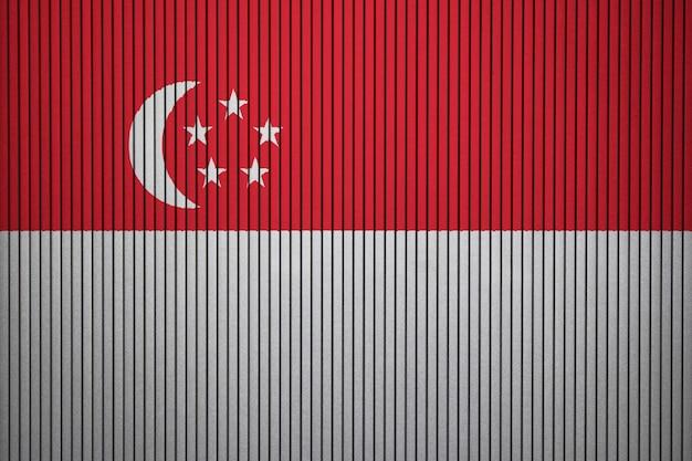 Drapeau national peint de singapour sur un mur de béton Photo Premium
