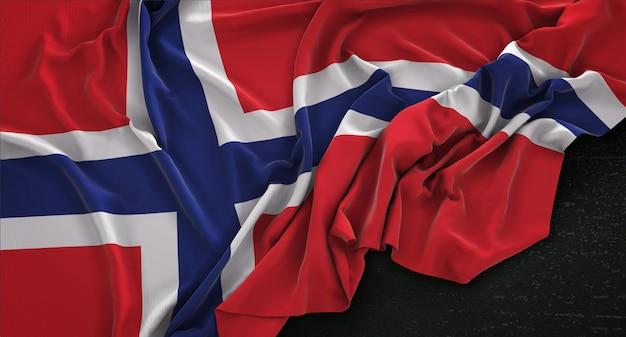 Drapeau De La Norvège Enroulé Sur Un Fond Sombre 3d Render Photo gratuit