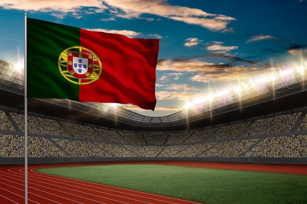 Drapeau Portugais Devant Un Stade D'athlétisme Avec Des Fans. Photo gratuit