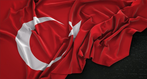 Drapeau De La Turquie Enroulé Sur Un Fond Sombre 3d Render Photo gratuit
