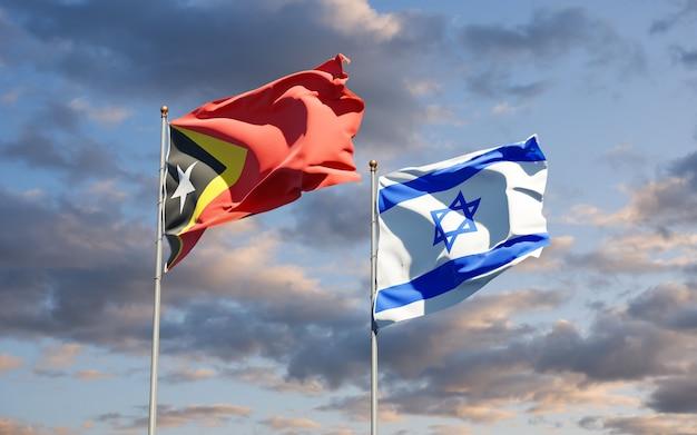 Drapeaux D'état Du Timor Oriental Et D'israël Ensemble Sur Fond De Ciel Photo Premium