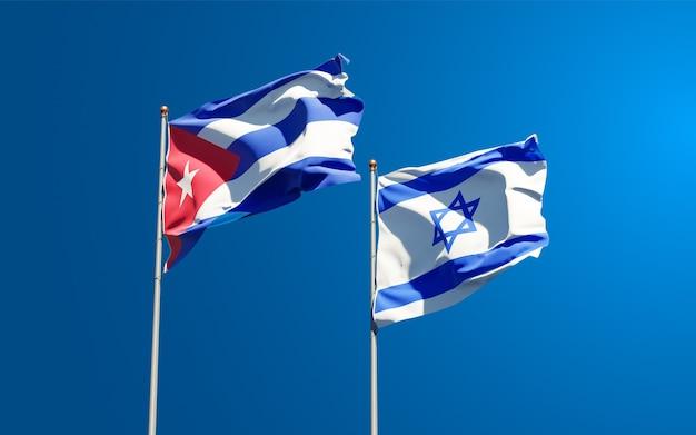 Drapeaux D'état D'israël Et De Cuba Ensemble Sur Fond De Ciel Photo Premium