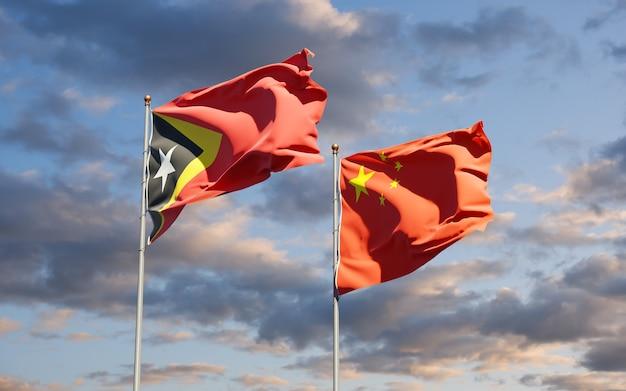 Drapeaux Nationaux Du Timor Oriental Et De La Chine Ensemble Photo Premium
