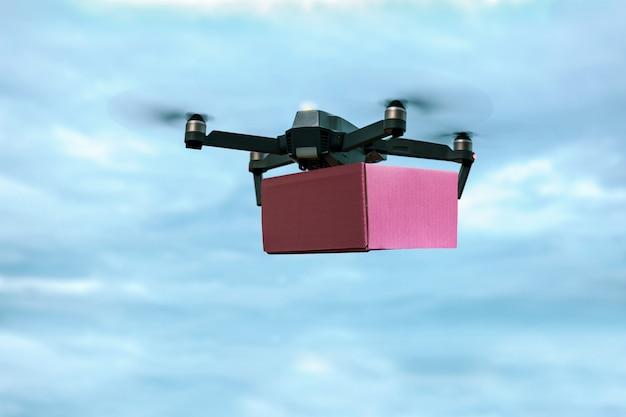 Drone Transportant Une Boîte Aux Lettres Pour Une Livraison Rapide. Photo Premium