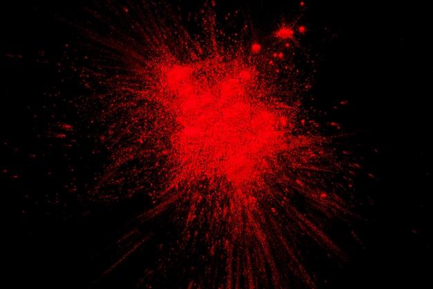 Éclaboussure De Peinture Rouge Sur Une Surface Noire Photo Premium