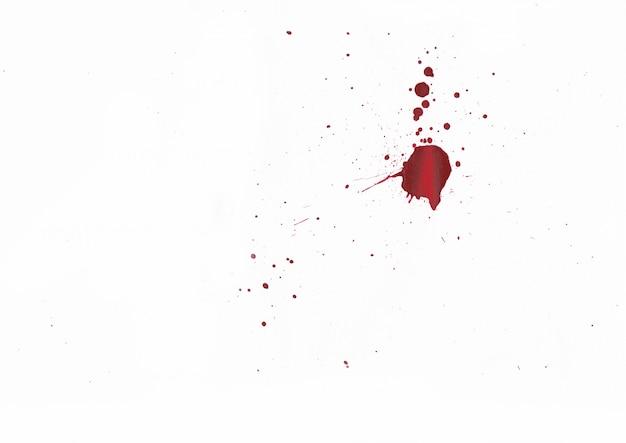 Éclaboussures de sang sur fond blanc Photo Premium