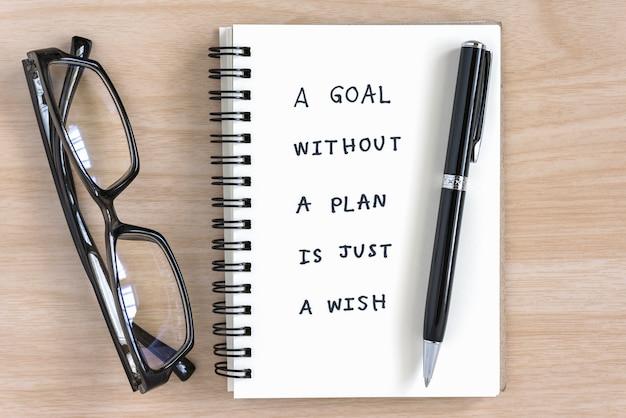 Écriture De Motivation Sur Un Cahier Photo gratuit