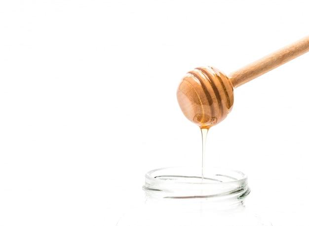 Égouttement de miel en pot Photo Premium
