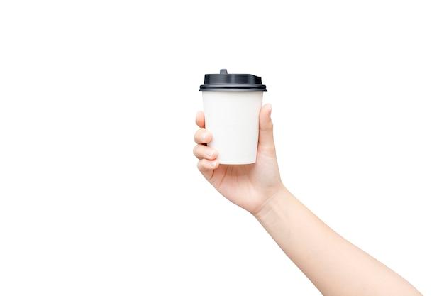 Emporter une tasse de café. femme main tenant un gobelet en papier café isolé Photo Premium