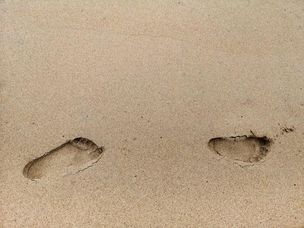Empreinte sur le fond de sable de la plage. Photo Premium