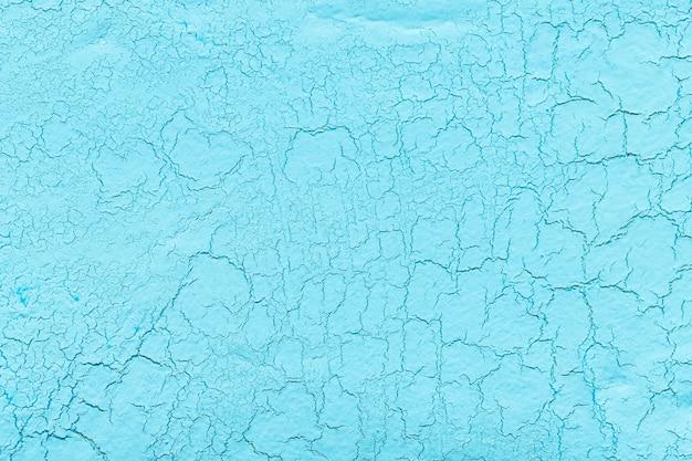 Enduit à la chaux bleu clair avec fond fissuré Photo gratuit