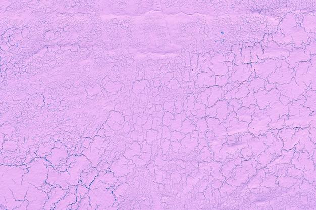 Enduit de chaux rose avec fond fissures Photo gratuit