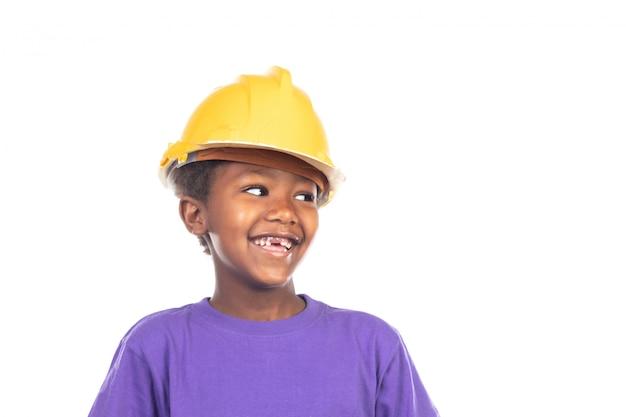Enfant mignon avec casque jaune Photo Premium