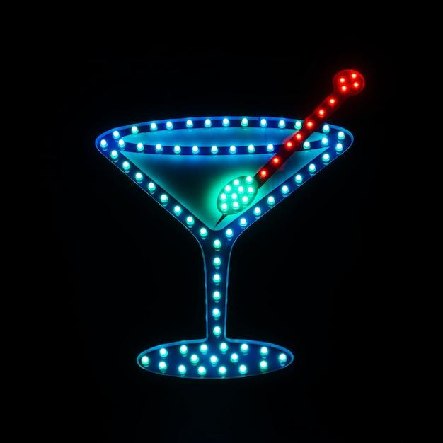 Enseigne au néon dans un bar avec une image de cocktail Photo gratuit