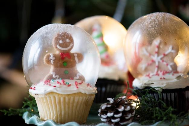 Ensemble de boules à neige de cupcake de noël Photo gratuit
