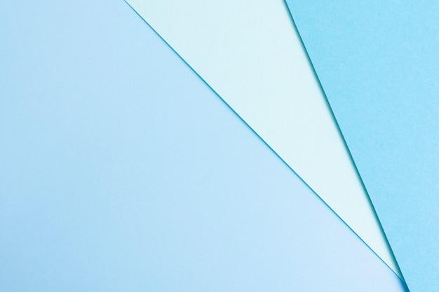 Ensemble de feuilles de papier bleu avec espace de copie Photo gratuit