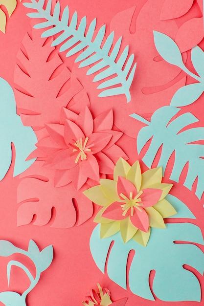 Ensemble de fleurs en papier origami, branches sur corail vivant Photo Premium