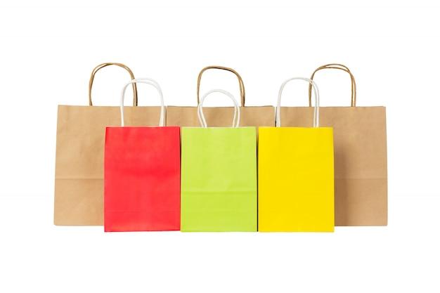 Ensemble de sacs à provisions en papier coloré et brun isolé Photo Premium