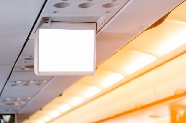 Espace publicitaire sur le moniteur à l'intérieur de l'avion Photo Premium
