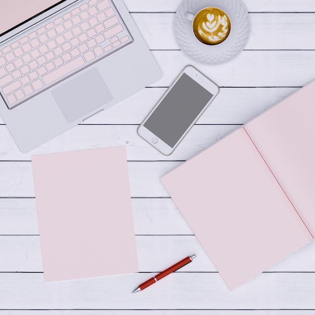 Espace De Travail Rose Avec Café En Papier Pour Ordinateur Portable Et Téléphone, Vue De Dessus Photo Premium