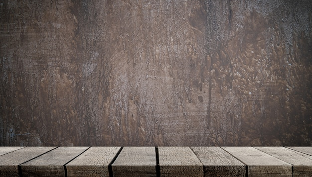 Étagère en bois vide sur un mur de ciment gris pour l'affichage des produits Photo Premium