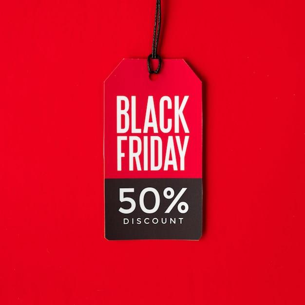 Étiquette de réduction de vendredi noir sur fond rouge Photo gratuit