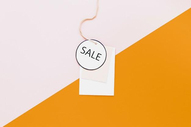 Étiquette de vente sur fond bicolore Photo gratuit