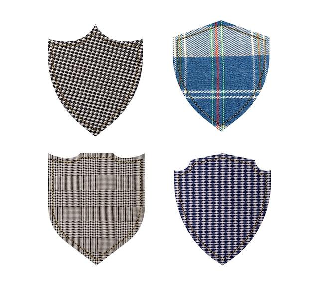 Étiquettes Textiles. Boucliers De Texture De Tissu Isolés Sur Blanc Photo Premium